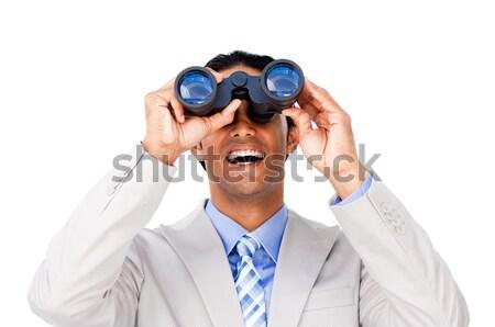 Joyful businesswoman predicting future success through binoculars isolated on a white background Stock photo © wavebreak_media