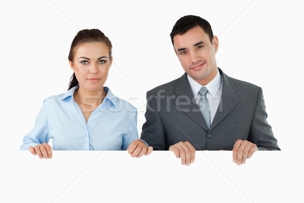 Business partners holding sign against a white background Stock photo © wavebreak_media