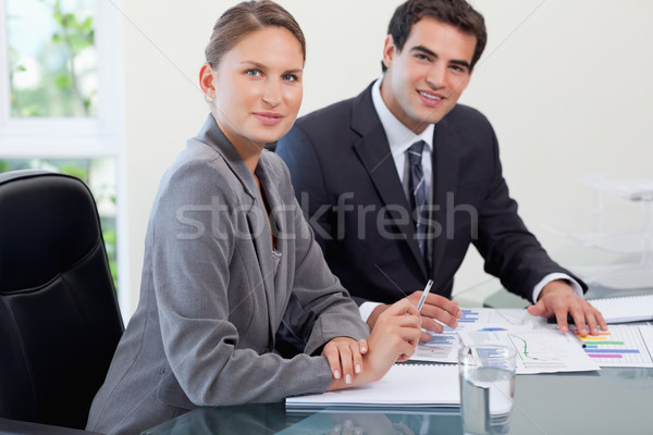 Young business team studying statistics in a meeting room Stock photo © wavebreak_media