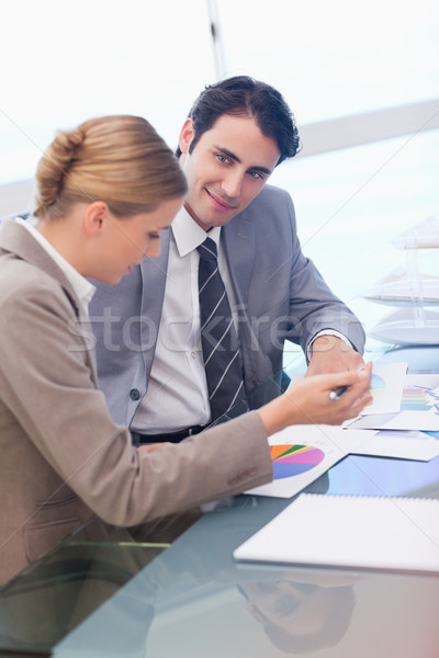 Portrait of business people looking at statistics in a meeting room Stock photo © wavebreak_media