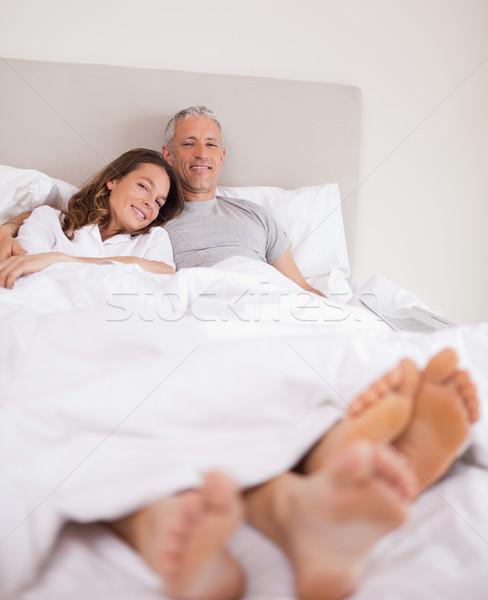 портрет пару кровать глядя камеры улыбка Сток-фото © wavebreak_media