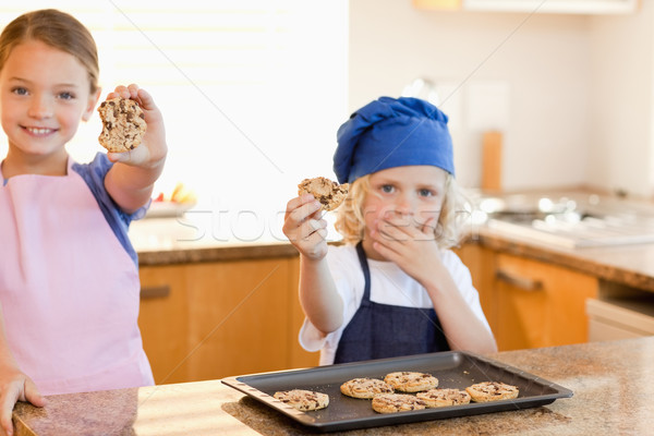 Siblings showing their cookies in the kitchen Stock photo © wavebreak_media