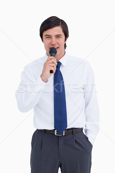 Young tradesman talking with microphone against a white background Stock photo © wavebreak_media