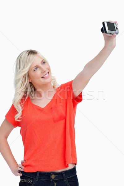 Mosolyog tinédzser pózol digitális fényképezőgép fehér mosoly Stock fotó © wavebreak_media