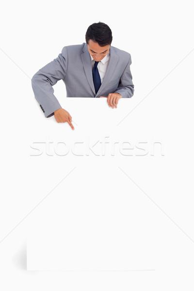 Uomo dietro grande poster bianco sorriso Foto d'archivio © wavebreak_media