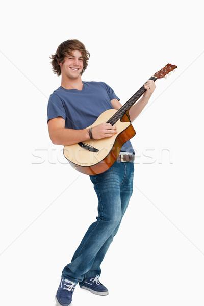 Homme étudiant posant jouer guitare blanche Photo stock © wavebreak_media