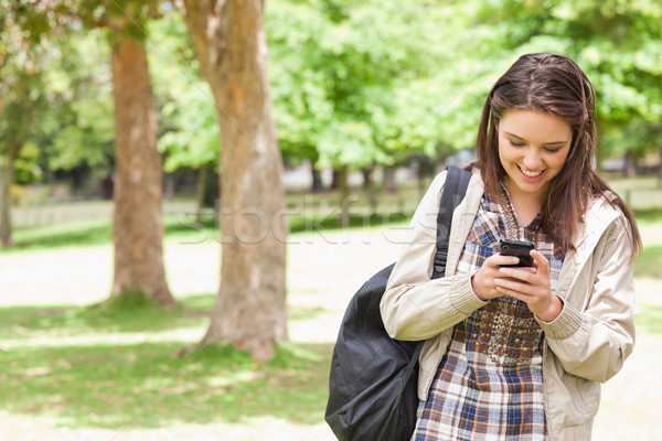 Young student using a smartphone in a park Stock photo © wavebreak_media
