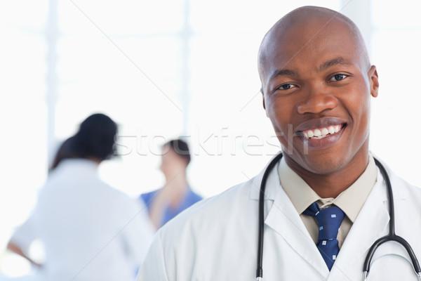 Stock fotó: Fiatal · orvos · áll · sztetoszkóp · körül · nyak