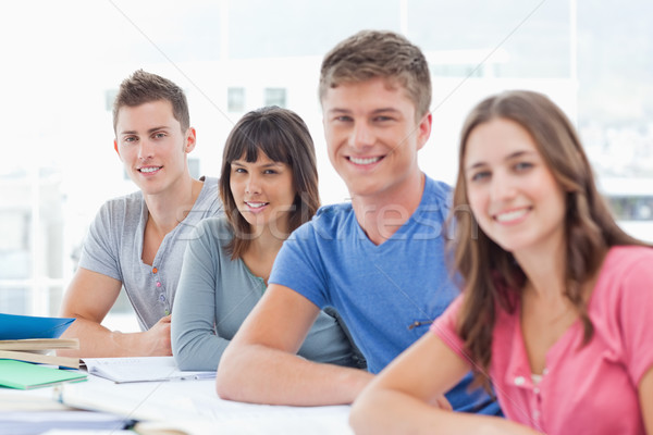 A side view shot of four students looking and turned towards the camera  Stock photo © wavebreak_media