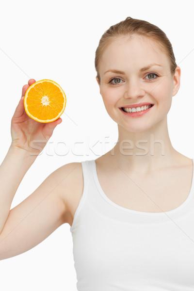 Mosolygó nő tart narancs fehér kéz női Stock fotó © wavebreak_media