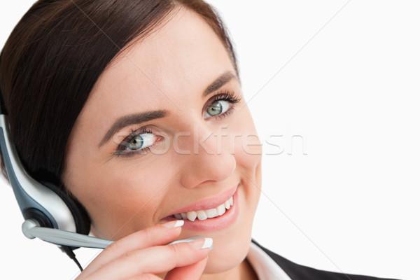 Femme souriante costume casque blanche heureux yeux Photo stock © wavebreak_media