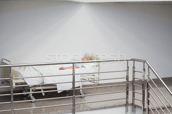 Idoso paciente adormecido corredor hospital entrada Foto stock © wavebreak_media