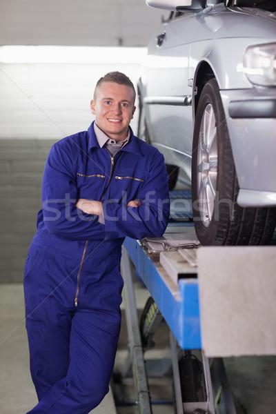 Man standing next to a car in a garage Stock photo © wavebreak_media