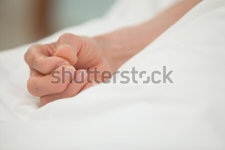 Hand in a white bed cover Stock photo © wavebreak_media