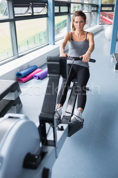 брюнетка женщину подготовки машина спортзал Сток-фото © wavebreak_media
