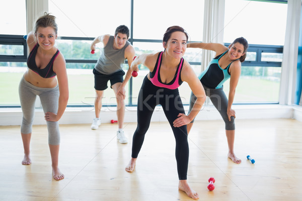 Happy people in aerobics class in fitness studio Stock photo © wavebreak_media