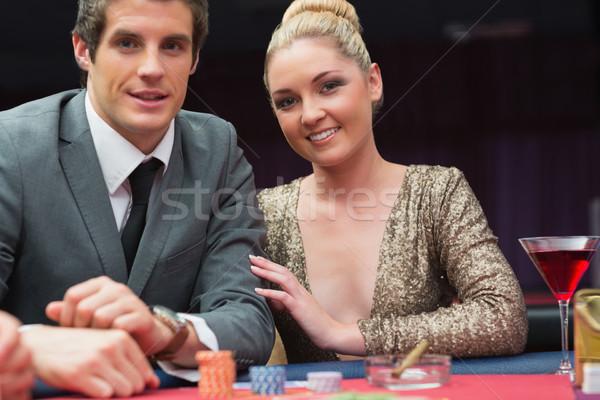 Coppia giocare poker casino uomo felice Foto d'archivio © wavebreak_media