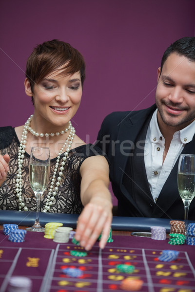Woman placing roulette bet with man in casino Stock photo © wavebreak_media