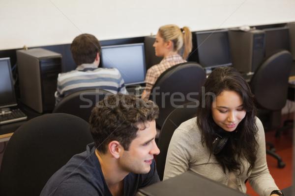 Dört kişi kolej bilgisayar sınıf Internet adam Stok fotoğraf © wavebreak_media