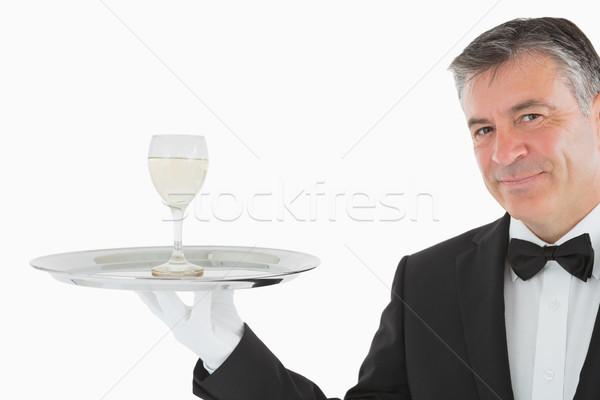 Uśmiechnięty człowiek garnitur szkła białe wino Zdjęcia stock © wavebreak_media