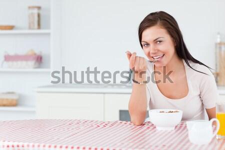 Portrait of smiling woman holding sponge Stock photo © wavebreak_media
