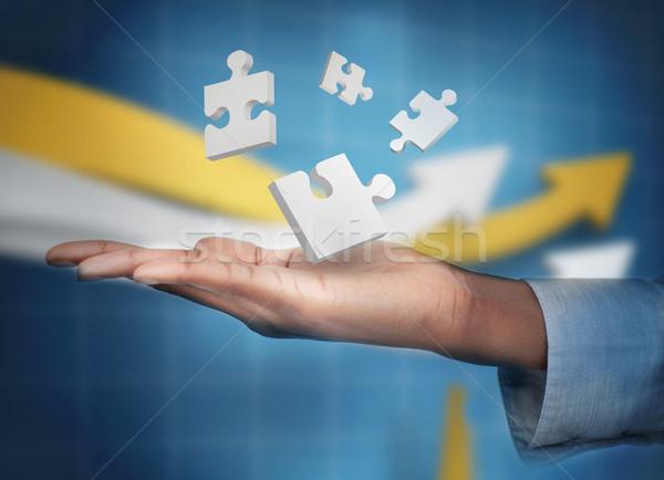 Hand with digital white puzzles levitating Stock photo © wavebreak_media