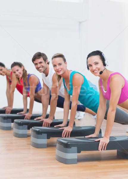 Fitness class doing step aerobics exercise Stock photo © wavebreak_media