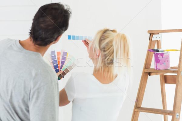 Hátsó nézet pár választ szín festmény szoba Stock fotó © wavebreak_media
