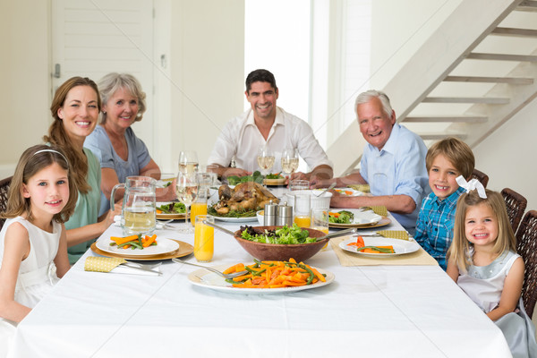 Stock photo: Family having meal together at dining table