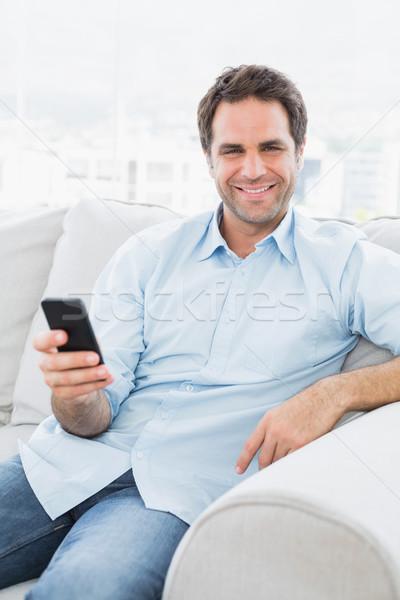 улыбаясь человека сидят диване текста Сток-фото © wavebreak_media