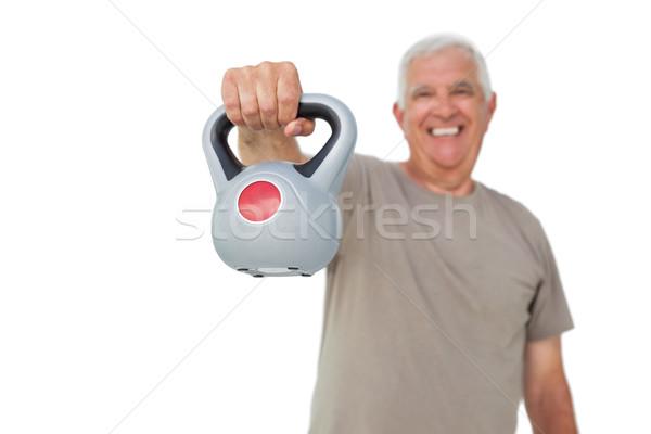 Portrait of a senior man exercising with kettle bell Stock photo © wavebreak_media