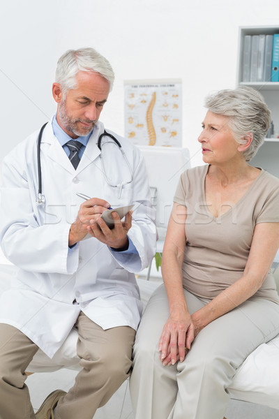 Stock photo: Female senior patient visiting a doctor