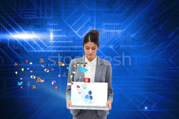 Empresária laptop aplicativo ícones composição digital Foto stock © wavebreak_media