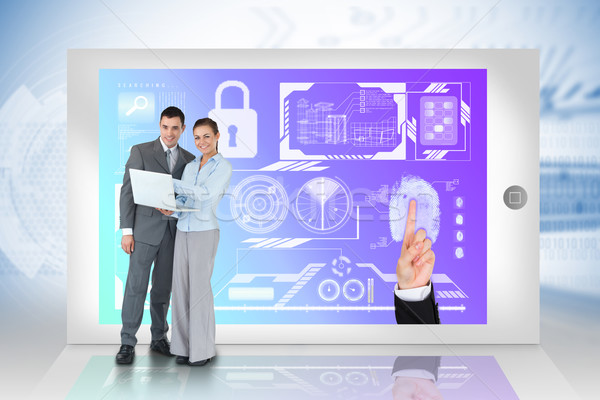 Happy business team using laptop with security interface on tabl Stock photo © wavebreak_media