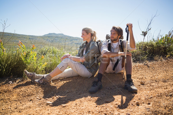 Hiking couple taking a break on mountain terrain Stock photo © wavebreak_media