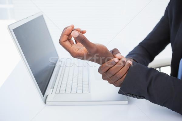 Zakenman pijnlijk pols typen kantoor Stockfoto © wavebreak_media