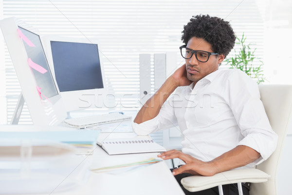 Stock photo: Hipster businessman working at his desk