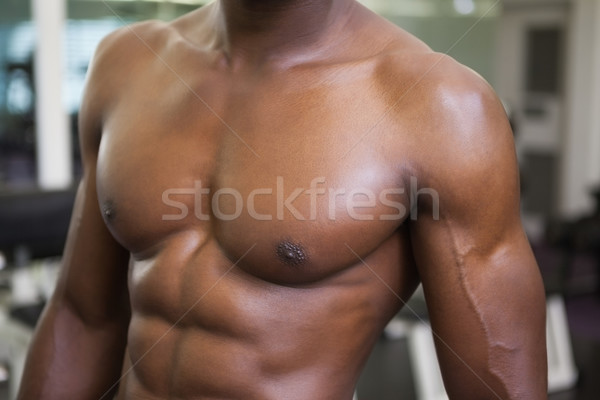 Mid section of a muscular shirtless man in gym Stock photo © wavebreak_media