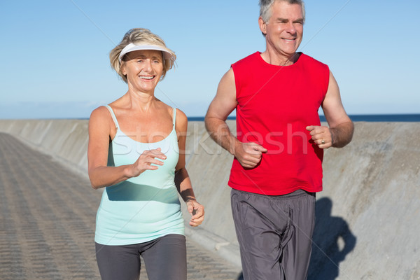 Active senior couple out for a jog Stock photo © wavebreak_media