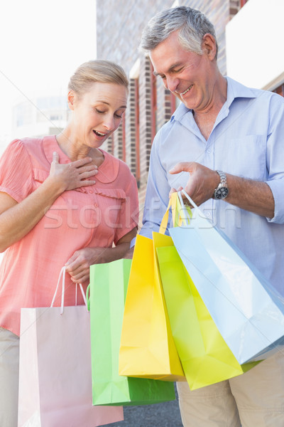 Happy senior couple shopping in the city Stock photo © wavebreak_media