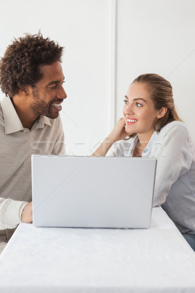 Happy couple on a date using laptop Stock photo © wavebreak_media