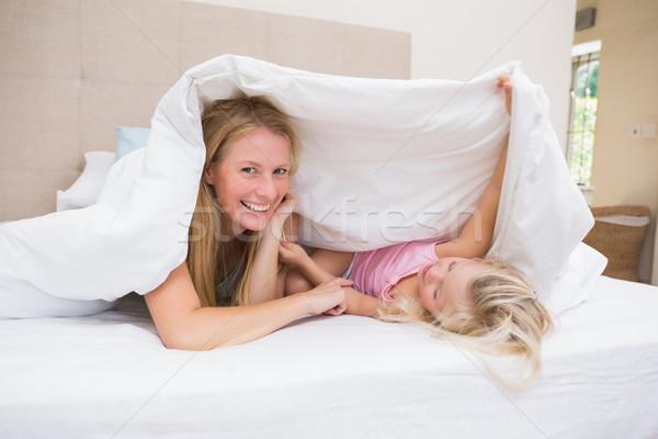 Cute meisje moeder bed home slaapkamer Stockfoto © wavebreak_media