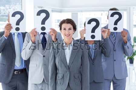 Business people holding question mark signs in office Stock photo © wavebreak_media