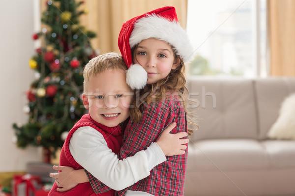 Festive siblings smiling at camera Stock photo © wavebreak_media