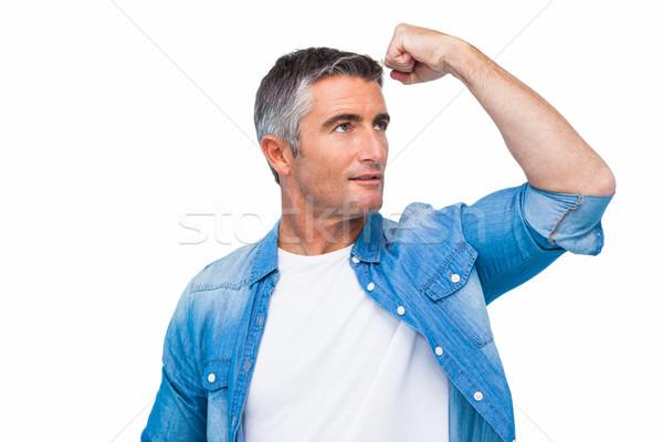 Man with grey hair tensing arm muscle Stock photo © wavebreak_media