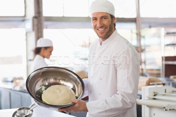 Baker showing dough in mixing bowl Stock photo © wavebreak_media