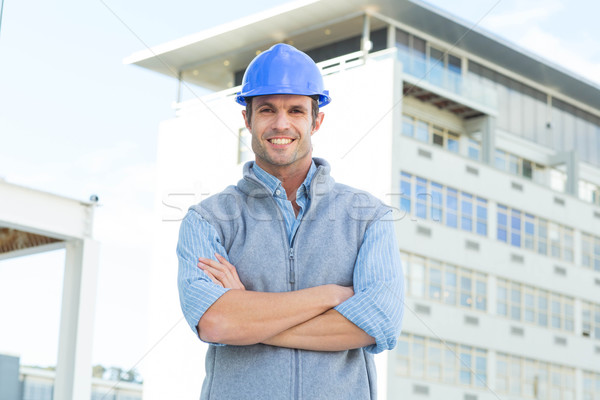 Male architect standing arms crossed outside building Stock photo © wavebreak_media