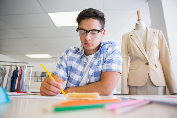 Concentrated college student drawing picture Stock photo © wavebreak_media