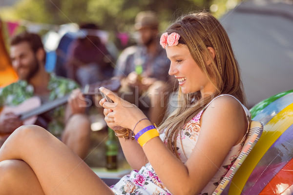 Pretty hipster sending text message Stock photo © wavebreak_media