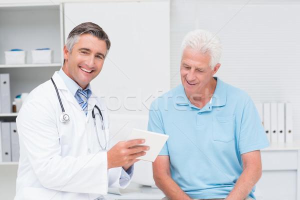 Doctor explaining prescription to senior man Stock photo © wavebreak_media
